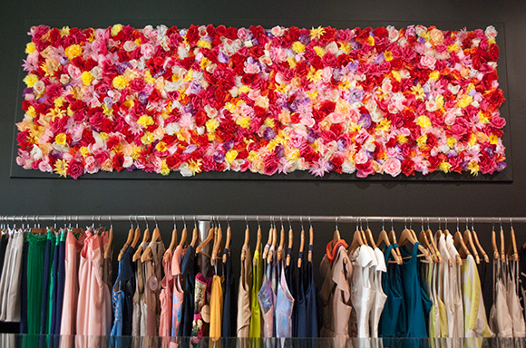 flowers on wall at principessa and clothing rack